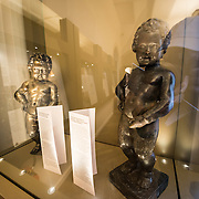The original Mannekin Pis on display at the Museum of the City of Brussels. The museum is dedicated to the history and folklore of the town of Brussels, its development from its beginnings to today, which it presents through paintings, sculptures, tapistries, engravings, photos and models.