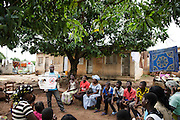 A staff member from UNICEF partner OIS Arique speaks about female genital mutilation during a community gathering in the town of Katiola, Cote d'Ivoire on Saturday July 13, 2013.