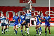 Featherstone Rovers winger Shaun Robinson (2) challenges for the high kick during the Challenge Cup 2018 match between Doncaster and Featherstone Rovers at the Keepmoat Stadium, Doncaster, England on 22 April 2018. Picture by Simon Davies.