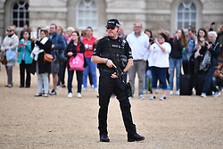 © Licensed to London News Pictures. 16/09/2017. London, UK. Armed police watch over at House Guards in Westminster, London  the day after a bomb partly exploded on a tube train at Parsons Green station in London injuring members of the public. Operation temperer has been put in to place after the UK terror threat level was raised to critical. Photo credit: Ben Cawthra/LNP