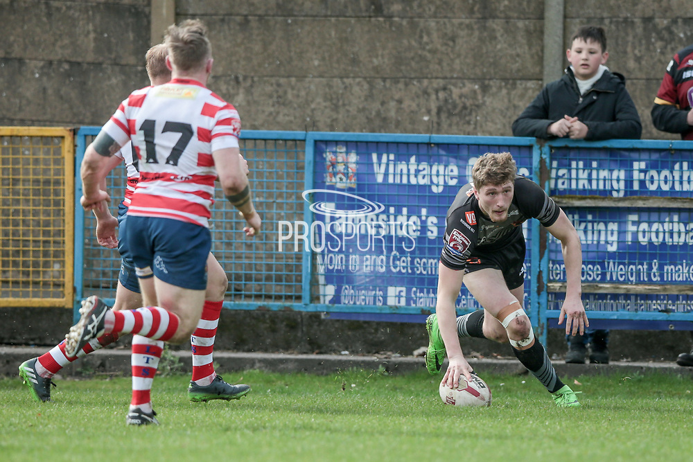 Ethan Ryan (Bradford Bulls) scores the third try for the visitors, 14-6 to the Bradford Bulls during the Kingstone Press Championship match between Oldham Roughyeds and Bradford Bulls at Bower Fold, Oldham, United Kingdom on 2 April 2017. Photo by Mark P Doherty.
