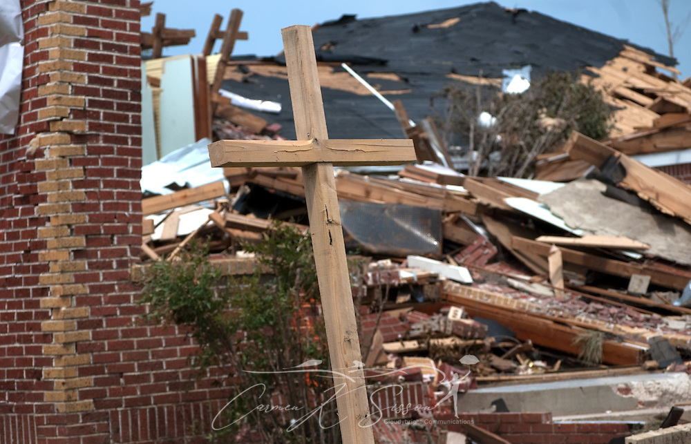A wooden cross stands in front of the ruins of Smithville United Methodist Church May 1, 2011 in Smithville, Miss. Sixteen people died in the town during an April 27, 2011 EF5 tornado, part of a storm system that swept across six states in the South, killing 342 people and injuring thousands. (Photo by Carmen K. Sisson/Cloudybright)