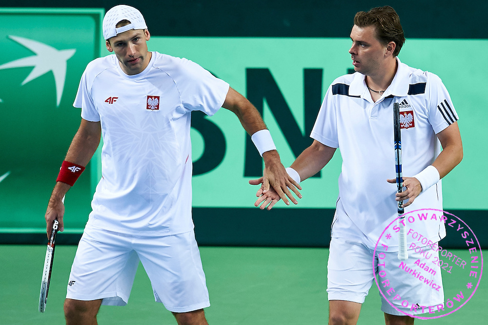 (L) Lukasz Kubot and (R) Marcin Matkowski both of Poland in action during second day the Davies Cup / Group I Europe / Africa 1st round tennis match between Poland and Lithuania at Orlen Arena on March 7, 2015 in Plock, Poland<br /> Poland, Plock, March 7, 2015<br /> <br /> Picture also available in RAW (NEF) or TIFF format on special request.<br /> <br /> For editorial use only. Any commercial or promotional use requires permission.<br /> <br /> Mandatory credit:<br /> Photo by &copy; Adam Nurkiewicz / Mediasport