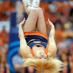 A Syracuse cheerleader performs a back-flip during a break in the action between the Long Beach State 49ers and the Syracuse Orange in the second half at the Carrier Dome in Syracuse, New York. No. 4 Syracuse defeated Long Beach State 84-53.