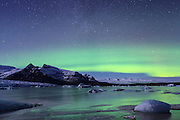 Aurora borealis over Fjallsjokull and Fjallsarlon. Vatnajokull National Park. Iceland.