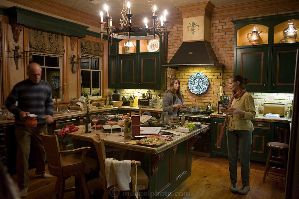 Daryl Sattui and wife Yana Albert's kitchen of their Victorian house in Calistoga, California, Napa Valley, California. Faith D'Aluisio at right. MODEL RELEASED.