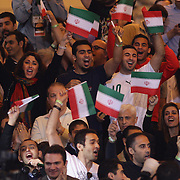 Iranian supporters cheer their team as wrestlers from USA, Iran and Russia compete at Grand Central Terminal as part of the Beat the Streets Gala. Billed ?The Rumble On The Rails,? the international wrestling event showcased competition as part of World Wrestling Month. Vanderbilt Hall, Grand Central Station, Manhattan,New York. USA. 15th May 2013. Photo Tim Clayton