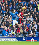 7th April 2018, Ibrox Stadium, Glasgow, Scotland; Scottish Premier League football, Rangers versus Dundee; Mark O'Hara of Dundee and Declan John of Rangers battle in the air