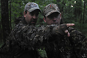 """Freddie McGuire points out a turkey to Peter Foster, a british journalist and hunter...Stalking a turkey from the woodline late in the turkey season..""""The Spring Gobbler"""" turkey hunting season in Augusta County, Virginia with Max Rowe, 42, of the Cable TV hunting programme """"Just Kill'n Time TV"""", and Freddy McGuire, who, according to Max, is """"the best Turkey hunter I know""""..The turkey season starts in mid-April and lasts for six weeks."""