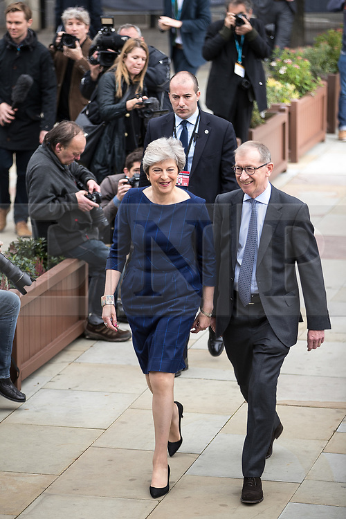 © Licensed to London News Pictures . 04/10/2017. Manchester, UK. Prime Minister THERESA MAY and her husband PHILIP MAY cross to the auditorium ahead of Theresa May delivering her keynote speech on the fourth and final day of the Conservative Party Conference at the Manchester Central Convention Centre . Photo credit: Joel Goodman/LNP