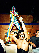 Two clubbers at Cream stripey body suit black corset whip Ibiza 1999