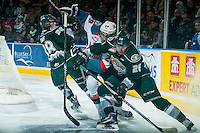 KELOWNA, CANADA - JANUARY 24: Leon Draisaitl #29 of Kelowna Rockets checks Cole MacDonald #26 of Everett Silvertips behind the net during first period on January 24, 2015 at Prospera Place in Kelowna, British Columbia, Canada.  (Photo by Marissa Baecker/Shoot the Breeze)  *** Local Caption *** Leon Draisaitl; Cole MacDonald;