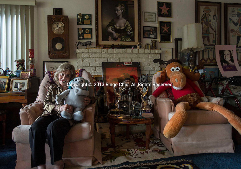 Voice actress June Foray, 96, poses with the Rocky and Bullwinkle,  animated cartoon characters of the Rocky and Bullwinkle Show,  at her home in Woodland Hill, Calif., Tuesday, Dec. 17, 2013. Foray was the voicce of Cinfy-Lou Who in the original 1966 Grinch Cartoon. (Photo by Ringo Chiu/For TheToronto Star)
