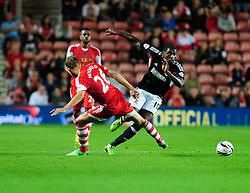 Bristol City's Jay Emmanuel-Thomas avoids a challenge from Southampton's Jos Hooiveld - Photo mandatory by-line: Dougie Allward/JMP - Tel: Mobile: 07966 386802 24/09/2013 - SPORT - FOOTBALL - St Mary's Stadium - Southampton - Southampton V Bristol City - Capital One Cup