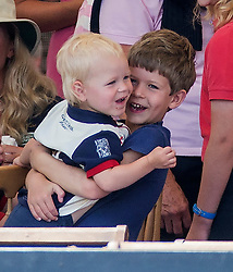 ames Viscount Severn (son of Sophie and Prince Edward) plays with his cousin Isla Phillips during lunch at Gatcombe this afternoon. Image ©Licensed to i-Images Picture Agency. 02/08/2014. Minchinhampton, United Kingdom. Gatcombe Festival of Eventing. Gatcombe Park. Picture by i-Images