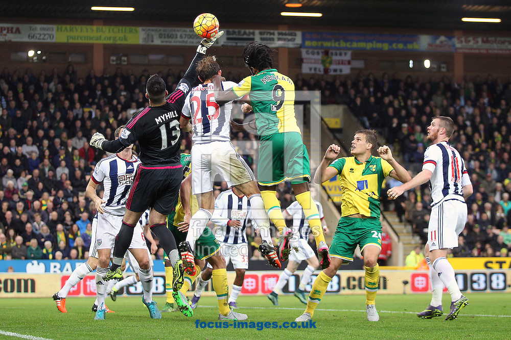 Boaz Myhill of West Bromwich Albion, Craig Dawson of West Bromwich Albion and Dieumerci Mbokani of Norwich compete for the ball during the Barclays Premier League match at Carrow Road, Norwich<br /> Picture by Paul Chesterton/Focus Images Ltd +44 7904 640267<br /> 24/10/2015