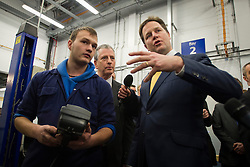 © London News Pictures. 11/02/2013 . Eastleigh, UK.  Leader of the Liberal Democrat Party, NICK CLEGG (Right)  with the Liberal Democrat part candidate for the Eastleigh by-election MIKE THORNTON (centre) speaking to automotive studies students during a visit to Eastleigh College in Eastleigh, Hampshire on February 11, 2013. The by-election was called when the former MP for Eastleigh, Chris Hune, resigned after admitting perverting the course of justice. Photo credit : Ben Cawthra/LNP