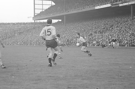 Dublin is in possession as he attempts to get around Kerry during the All Ireland Senior Gaelic Football Final, Kerry v Dublin in Croke Park on the 28th September 1975. Kerry 2-12 Dublin 0-11.