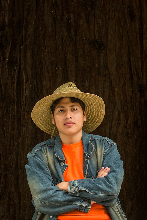 """""""My aunt started the US residency process for me in Mexico fourteen years ago.  I've been here two months...I'm totally legal!""""  -Nineteen year old Marvin Mendez pauses on Berry Street while walking home in Calistoga."""