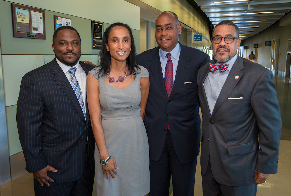 L-R: Dameion Crook, Alison Leland, Rodney Ellis and William Paul Thomas pose for a photograph following the naming of Young Men's College Preparatory Academy for Congressman Mickey Leland during a meeting of the Houston ISD Board of Trustees meeting, September 11, 2014.
