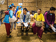 26 OCTOBER 2016 - NUPO TEMPORARY SHELTER, MAE CHAN, TAK, THAILAND: Burmese refugees in the Nupo Temporary Shelter refugee camp finish their paperwork before being repatriated to Myanmar. Sixtyfive Burmese refugees living in the Nupo Temporary Shelter refugee camp in Tak Province of Thailand were voluntarily repatriated to Myanmar. About 11,000 people live in the camp. The repatriation was the first large scale repatriation of Myanmar refugees living in Thailand. Government officials on both sides of the Thai / Myanmar border said the repatriation was made possible by recent democratic reforms in Myanmar. There are approximately 150,000 Burmese refugees living in camps along the Thai / Myanmar border. The Thai government has expressed interest several times in the last two years in starting the process of repatriating the refugees.     PHOTO BY JACK KURTZ