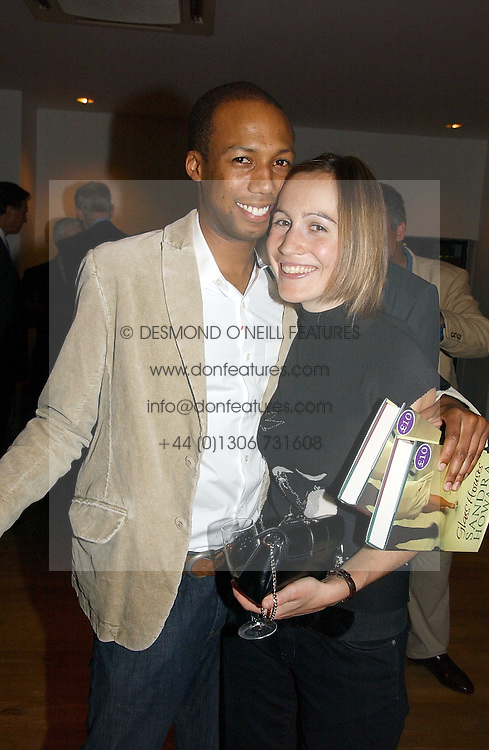 MR CONRAD PERSONS and his fiance LARISSA HOWARD daughter of Michael Howard  at a party to celebrate the publication of Glass Houses by Sandra Howard held at Tamesa, Oxo Tower Wharf, Barge House Street, London SE1 on 5th September 2006.<br /><br />NON EXCLUSIVE - WORLD RIGHTS