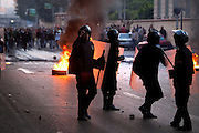 Egyptian riot police battle rock throwing protesters during continuing January 26, 2011 demonstrations in downtown Cairo, Egypt. A series of unprecedented demonstrations have broken out across Egypt for the past two days, inspired by the revolution in Tunisia, and intended to spark a similar movement in Egypt.(Photo by Scott Nelson)