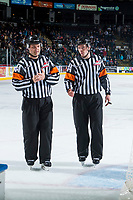 KELOWNA, CANADA - MARCH 31: Referees Chris Crich and Reid Anderson skate for the dressing room after the first period between the Kelowna Rockets and the Kamloops Blazers on March 31, 2017 at Prospera Place in Kelowna, British Columbia, Canada.  (Photo by Marissa Baecker/Shoot the Breeze)  *** Local Caption ***
