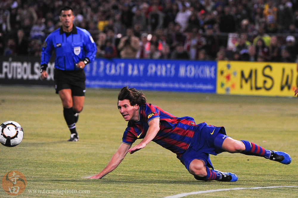 August 8, 2009; San Francisco, CA, USA; FC Barcelona forward Lionel Messi (10) falls during the first half in the Night of Champions international friendly contest against Chivas de Guadalajara at Candlestick Park.
