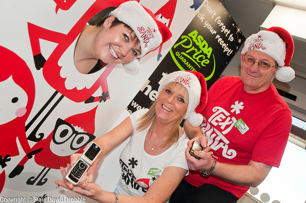 Text Santa  Charity Campaign Launch People Manager Sue Stringer with Asda collueuages John Somerville (right) and Jess Langan (left) Barrow Road Asda Harrogate. .www.pauldaviddrabble.co.uk.6 December 2011  Image © Paul David Drabble