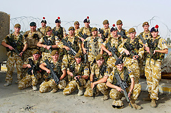 Soldiers from the East and West Riding Regiment, Territorial Army pose for a group picture in the grounds of the Shat Al Arab Hotel during a break in an mounted potarol through the streets of Basra during Op Telic in March 2005