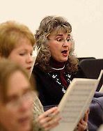 (left to right) Carla Ballou, Annette Rizer and Marilyn Smyers are three of the women of the Dayton Philharmonic Chorus rehearsing for their upcoming performance of Mahler's Third Symphony, Tuesday, January 2, 2007.