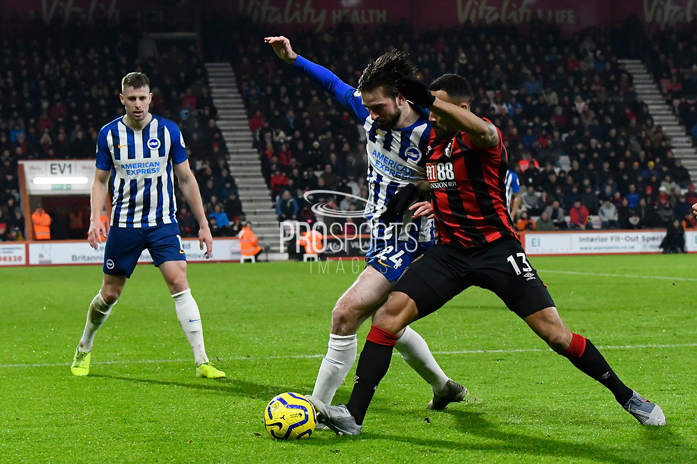 Davy Propper (24) of Brighton and Hove Albion battles for possession with Callum Wilson (13) of AFC Bournemouth during the Premier League match between Bournemouth and Brighton and Hove Albion at the Vitality Stadium, Bournemouth, England on 21 January 2020.
