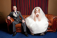 bride and groom sitting on a sofa at Woodbury Park