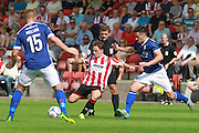 Jack Munns and George Williams during the Vanarama National League match between Cheltenham Town and Barrow at Whaddon Road, Cheltenham, England on 22 August 2015. Photo by Antony Thompson.