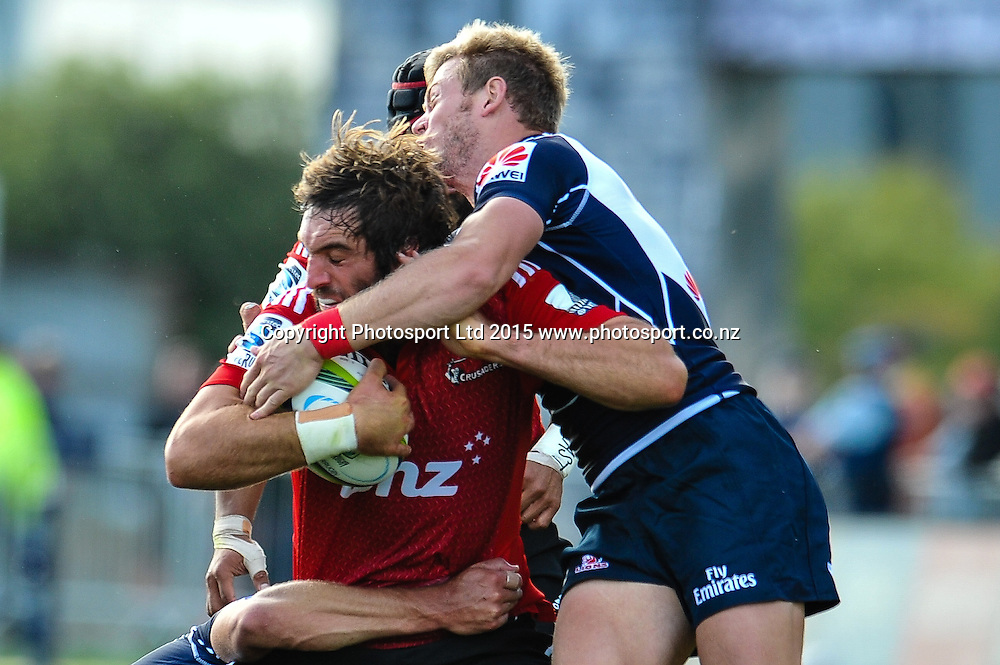 Sam Whitelock of the Crusaders gets tackled during the Super Rugby match: Crusaders v Lions at AMI Stadium, Christchurch, New Zealand, 14 March 2015. Copyright Photo: John Davidson / www.Photosport.co.nz