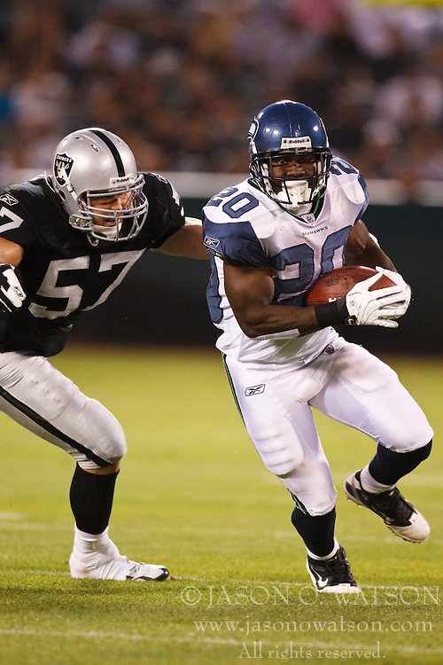 September 2, 2010; Oakland, CA, USA;  Seattle Seahawks running back Justin Forsett (20) is tackled by Oakland Raiders linebacker Ricky Brown (57) during the first quarter at Oakland-Alameda County Coliseum. Oakland defeated Seattle 27-24.