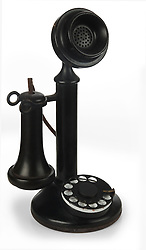 black candlestick phone on white background