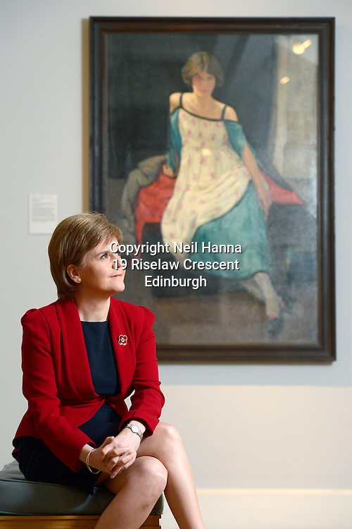 The Scottish National Gallery of Modern Art – Modern Two<br /> <br /> The First Minister of Scotland, Nicola Sturgeon, pays a visit to the Scottish National Gallery of Modern Art to officially open the National Galleries of Scotland's first major exhibition of the work of female Scottish artists, Modern Scottish Women: Painters and Sculptors 1885-1965.<br /> <br /> The First Minister views Dorothy Carleton Smyth's self-portrait. <br /> <br /> Dorothy Carleton Smyth (1880-1933)<br /> Self-portrait, 1921<br /> Oil on canvas, 76.8 x 68.6<br /> Glasgow Life (Glasgow Museums) on behalf of Glasgow City Council: Gift from Olive C. Smyth 1948<br />   <br />  Neil Hanna Photography<br /> www.neilhannaphotography.co.uk<br /> 07702 246823