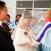 Bride's veil is put in place on wedding day. Namasiya Township, Kaoshiung County, Taiwan