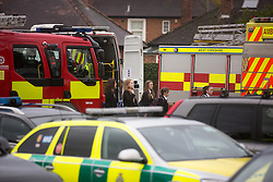 © Licensed to London News Pictures. 11/11/2015. Ripon, UK. Picture shows children being escorted out of the Outwood school. 27 children have been taken ill following a suspected gas leak at the Outwood academy school in Ripon. Two schoolchildren have been hospitalised after they suddenly collapsed at an academy in North Yorkshire today. Hazmat officers were called to Outwood Academy in Ripon after at least 27 pupils and one teacher were mysteriously taken ill at the same time. <br /> Initial reports claimed that the source of the illness may have a gas leak in the local area.<br /> Some of the children were treated at the scene by paramedics after falling ill around 11am, while an unknown number of others were taken to hospital. Photo credit: Andrew McCaren/LNP