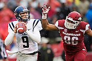 FAYETTEVILLE, AR - NOVEMBER 22:  Ryan Buchanan #9 of the Ole Miss Rebels drops back to pass under pressure from Trey Flowers #86 of the Arkansas Razorbacks at Razorback Stadium on November 22, 2014 in Fayetteville, Arkansas.  The Razorbacks defeated the Rebels 30-0.  (Photo by Wesley Hitt/Getty Images) *** Local Caption *** Ryan Buchanan; Trey Flowers