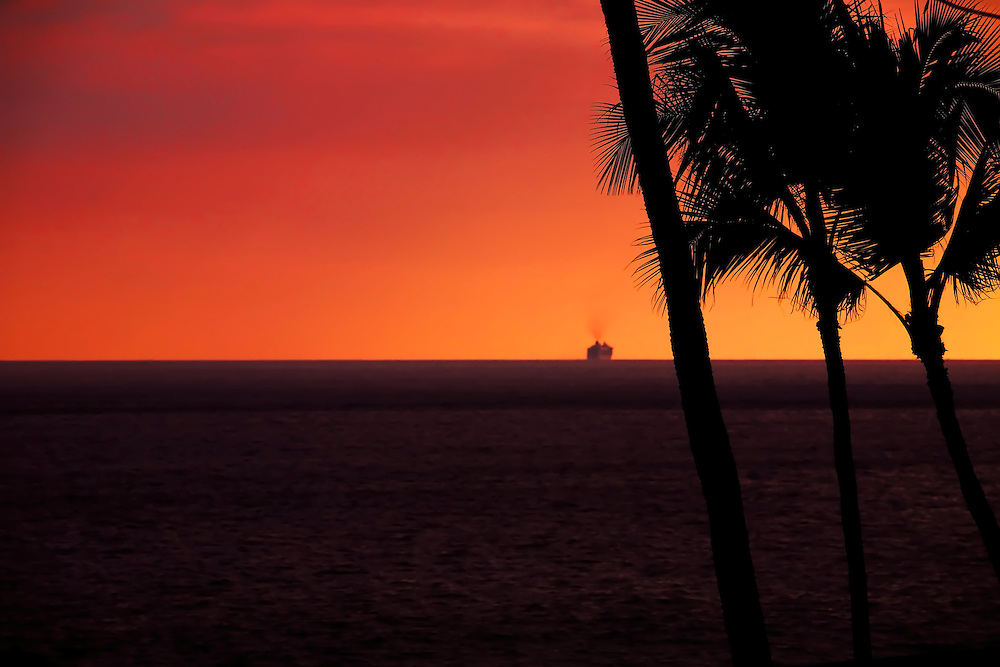 Ocean liner heads west in late evening, from Kona, Hi.  Copyright 2009 Reid McNally.