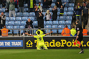 Southend United forward David Mooney celebrates his penalty in front of the loyal fans during the Sky Bet League 1 match between Coventry City and Southend United at the Ricoh Arena, Coventry, England on 31 August 2015. Photo by Simon Davies.
