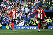 Sunderland defender, on loan from Athletico Madrid, Javi Manquillo (21) scores a goal and celebrates with Sunderland defender Joleon Lescott (15) celebrate  during the Premier League match between Chelsea and Sunderland at Stamford Bridge, London, England on 21 May 2017. Photo by John Potts.