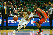 WACO, TX - JANUARY 3: Gary Franklin #4 of the Baylor Bears drives to the basket against the Savannah State Tigers on January 3, 2014 at the Ferrell Center in Waco, Texas.  (Photo by Cooper Neill) *** Local Caption *** Gary Franklin