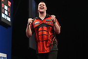 Daryl Gurney beats Brendan Dolan and celebrates during the Grand Slam of Darts, at Aldersley Leisure Village, Wolverhampton, United Kingdom on 11 November 2019.