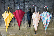 Colorful Umbrellas Leaning Against a Wall