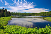 CLouds reflected in Lac Gauvin<br />Belleterre<br />Quebec<br />Canada