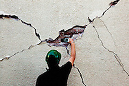 Juan Murciel takes a photo inside a large crack in a building on the campus of the Universidad Autónoma de Baja California. A group of researchers led by Dr. Benson Shing, Vice Chair of the Department of Structural Engineering at the University of California, San Diego, inspected the earthquake damage in Mexicali, Mexico, April 7, 2010. A 7.2 magnitude earthquake in Baja California on Easter Sunday was felt as far away as Los Angeles.